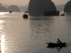woman-in-boat-at-sunset-ha-long-bay-vietnam