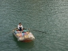 woman-selling-snacks-in-boat-2-ha-long-bay-vietnam
