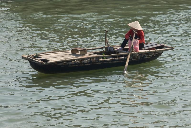 woman-in-boat-ha-long-bay-vietnam