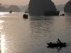 woman-in-boat-at-sunset-ha-long-bay-vietnam