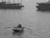 woman-in-boat-bw-ha-long-bay-vietnam